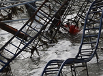 An image showing a roller-coaster ride swept into the sea by Super Storm Sandy